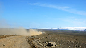 Dusty gravel road and Hofsjökull glacier lake on Iceland Stock Photos