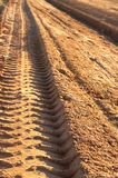 Dusty gravel road with imprint. Dusty gravel road with tyre imprints , shot at sunset Stock Photo