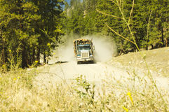 Dusty logging truck Stock Images