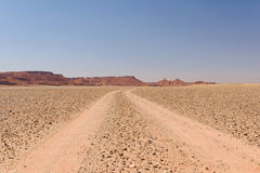 Dusty off-road track leading to the horizon, Morocco Royalty Free Stock Photos