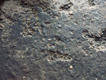 Dusty oily concrete surface. The broken dusty oily concrete floor Stock Photos