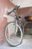 Dusty old bike in the corner Stock Image