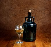 Dusty old bottle and glass of white wine Royalty Free Stock Photography