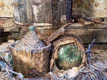 Dusty old demijohns, wine making in the past. Italy. Stock Photography