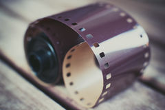 Dusty old photographic roll and film. Detail of dusty vintage photographic roll and unexposed negative film selective focus Stock Photos