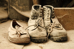 Dusty old shoes. Old dusty shoes in the attic of a mill royalty free stock photo