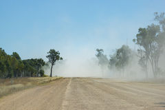 Dusty outback unsealed road. Clouds of dust from a truck driving on outback unsealed road Australia Royalty Free Stock Photos