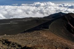 A dusty path between the lava craters of the Etna volcano Royalty Free Stock Images