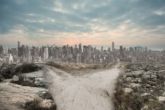 Dusty path leading to large city Stock Images