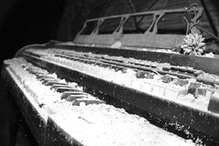 Dusty piano. In a abandon church sits this piano covered in dust Stock Photography