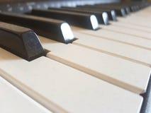 Dusty piano keyboard. Concept of resuming piano play Stock Photos