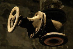 Dusty pipes. Old rusty, dusty pipes in a ruined old house royalty free stock photography