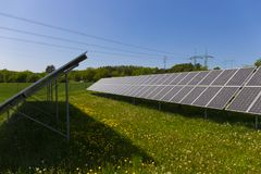 Dusty Pollen Solar Power Station on the spring Meadow with flowering Dandelions Stock Images