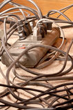 Dusty power cords tangled mess Royalty Free Stock Photography