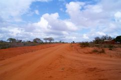 Dusty Red Way in Africa Safari Stock Images