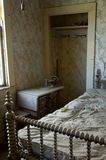 The dusty remains of a bedroom in ghost town, Bodie. royalty free stock photo