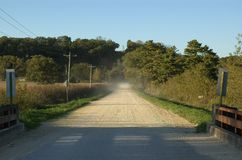 Dusty Road. A car leaves the photographer in the dust stock image