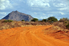 Dusty road in a African national park Royalty Free Stock Photo