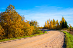 Dusty  road in fall Stock Photos