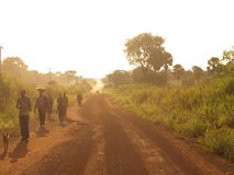 Dusty road in Ghana, Africa. Africa ghana west forest dust dusty road farmers poor poverty dusk golden hour path Royalty Free Stock Photography