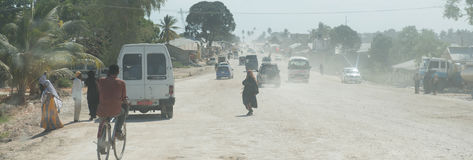 Dusty road leading to Zanzibar town Stock Images