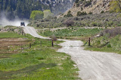 Dusty road in a mountain canyon Royalty Free Stock Images