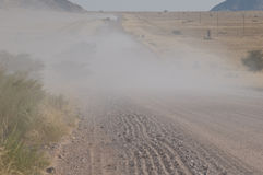 Dusty road in Namibia Royalty Free Stock Photography