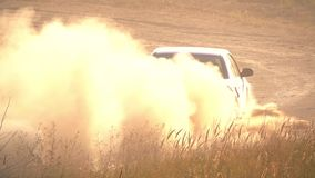 Dusty Road and Rally Car. Slow Motion stock video