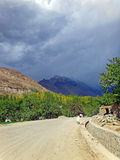 A Dusty Road in the Village in Hunza Valley. A Road in the Rural Village of Hunza Valley in Pakistan Royalty Free Stock Photography