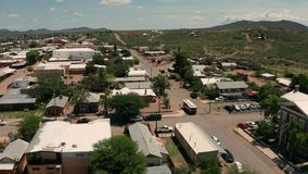 Aerial view sliding right over main street saloons and shops Tombstone AZ
