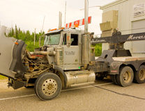 A dusty truck with it's engine exposed. A semi with its hood up at a repair station in canada stock photography