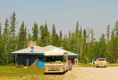 Dusty vehicles at a rest stop in the northwest territories Stock Images