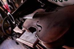 Dusty Violin. An antique violin gathers dust at the Old Opera House in Arcadia, Florida Stock Images