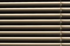 Dusty window blinds. Closed window blinds. Dust could be seen close-up Stock Image