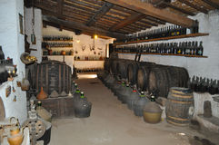 Dusty wine cellar. Bottles and barrels in a dusty wine cellar Stock Images