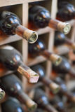 Dusty wine rack. Stock Photos
