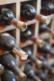 Dusty wine rack. Stock Photos