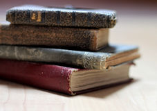 Dusty worn books. Stack of dusty worn books on poetry and and a bible stock images