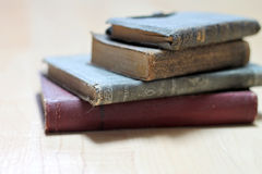 Dusty worn books. Stack of dusty worn books on poetry and and a bible stock photos