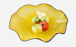 Dusty Yellow Bowl with Apples and Tomatoes. Picture of a dusty yellow bowl with small apples and tomatoes placed in it Stock Image