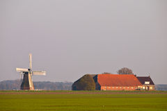 Dutch agricultural landscape. With farm and windmill Stock Image