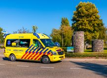 Dutch ambulance on roundabout stock photos