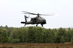 Dutch Apache attack helicopter above the heath. The royal netherlands air force has Apache AH-64D attack helicopters. The AH-64 Apache is a four-blade, twin Royalty Free Stock Photos