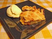 Dutch apple pie with ice cream. A plate of Dutch apple pie with vanilla ice cream Royalty Free Stock Photography