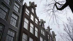 Dutch architecture. Traditional houses in Amsterdam. From below view of buildings in national Dutch style with elements of Art Nouveau, classicism and stock video