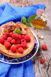 Dutch baby pancake with apple  cinnamon and fresh. Dutch baby pancake with apple and cinnamon and fresh raspberries Royalty Free Stock Images