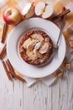 Dutch baby pancake with apple closeup. Vertical top view Royalty Free Stock Photos