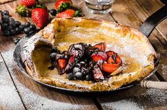 Dutch Baby Pancakes with berries and chocolate Royalty Free Stock Photography