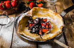 Dutch Baby Pancakes with berries and chocolate Stock Photography