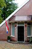 A dutch be-flagged house. The daughter of this family is going to marriage and therefore the flag has been put out Royalty Free Stock Images